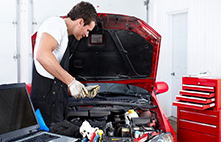 Mechanic looking under the hood