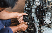 Mechanic working on transmission
